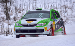 COVASNA, ROMANIA - January 16: Unknown pilots competing in Winter Rally Covasna 2016 on January 16, in Covasna, Romanaia. COVASNA, ROMANIA - January 16: Unknown Stock Photo