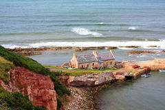 Cove Bay. Scottish seashore with old abandoned houses Royalty Free Stock Photo