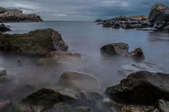 Cove Bay by Noon. A slightly remote bay just outside Aberdeen. Set up my camera on a tripod and took some long exposure shots Royalty Free Stock Photography