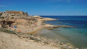 Cove with castle Mediterranean sea Almeria Spain. Cove in the Cabo de Gata-Nijar natural park with the castle of San Ramon in background, el Playazo de royalty free stock photography