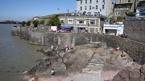 Cove cafe Madeira Cove Weston-super-Mare Somerset in summer sunshine with tourists and visitors stock video footage