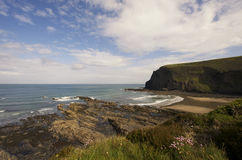 Cove at Crackington Haven UK. A view overlooking a sandy beach and steep cliffs along the English coast at Crackington Haven, Cornwall, UK Stock Images