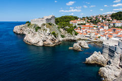 Cove and docks guarded by city walls and Fort Lovrijenac at Dubr. DUBROVNIK, CROATIA - JULY 19th, 2016: sea cove and docks guarded by Pile Gate walls and Fort royalty free stock photos