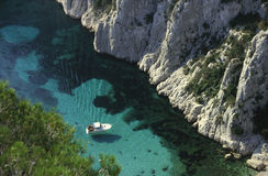 Cove of dreams. Little boat in the cove Calanque En Vau Mediterranean Sea - South of France Royalty Free Stock Image