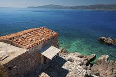 Cove at Monemvasia peninsula with an old house royalty free stock image