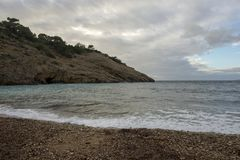 Cove in San Antonio de Ibiza a cloudy day. Spain stock photography