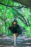 COVEN. In the cap and raincoat. royalty free stock photography