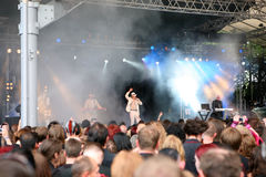 Covenant - Amphi festival. Swedish electro / electronic body music band Covenant on stage with audience in the foreground royalty free stock image
