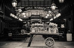 Covent Garden London vintage looking market place with vintage cart royalty free stock images