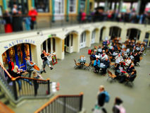 Covent Garden Music. Tilt Shift shot of people listening and watching artists perfom at Covent Garden London Stock Image