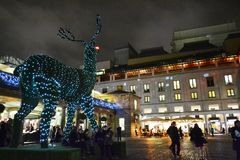 Covent Garden square by night decorated for Christmas with giant topiary reindeer. stock photography