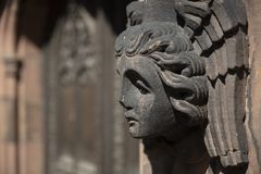 Coventry, Warwickshire, UK, June 27th 2019, A carved angels head on the Cathedral Church of Saint Michael. Coventry, Warwickshire, United Kingsom, June 27th 2019 royalty free stock photo