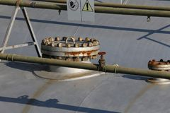 Tank to contain methane gas in an industrial aerial. Cover with bolts over big tank to contain methane gas in an industrial aerial Stock Photos