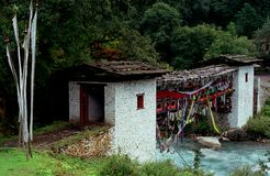 Cover bridge w prayer flags. A cover bridge near Paro, Bhutan cover with different colors prayer flags Stock Image