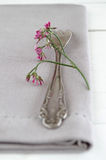 Cover with cake fork and flowers Royalty Free Stock Photo
