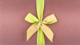 Cover gift box with green bow. Cover a gift box with a green bow Stock Photography