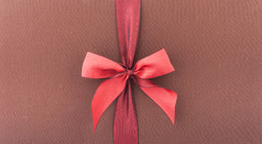 Cover gift box with red bow. Cover a gift box with a red bow Stock Image