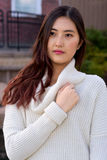 Cover-girl. Portrait of a beautiful young Asian model in the park during a chilly day.n stock photos