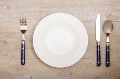 Cover with knife, fork and spoon on a dining table Royalty Free Stock Images