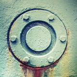 Cover mounted with bolts, abstract old industrial detail Stock Images