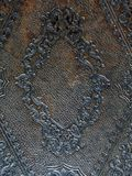 Cover of Old English Bible. The front cover of a medieval bible from a church in Suffolk, England, of leather with a faded silver gilt engraved pattern. This may royalty free stock photos