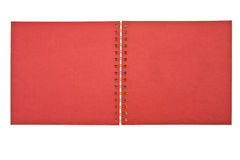 Cover of an open red notebook. Cover of an open red spiral notebook isolated on white Royalty Free Stock Image