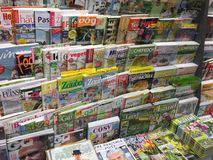 Cover pages of magazines. Berlin, Germany - March 15, 2018: newsstand interior, cover pages of German magazines displayed for sale on a stand stock photography