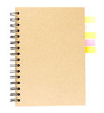Cover of spiral notebook on white with colorful note paper Stock Images