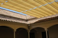 Cover and tiled roof at the patio of a building in Malaga Spain royalty free stock photo