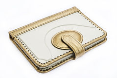 Cover in white with gilt braid. Case for Tablet PC on a white background royalty free stock photos