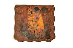 Cover of wooden box. Decorated with motive of The Kiss by Gustav Klimt, decoupage technique, isolated on white background Royalty Free Stock Images