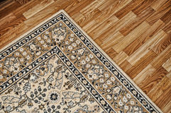 Cover on wooden floor. Traditional carpet cover on wooden parquete floor Stock Photos