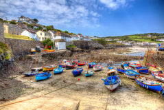 Coverack harbour Cornwall England UK boats at low tide in summer in creative HDR. Coverack harbour The Lizard peninsula Cornwall England UK in summer with blue Stock Photos
