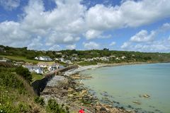 Coverack village in the Lizard Peninsula, Cornwall, UK. Early summer afternoon sunshine on old fashioned Coverack village in the Lizard Peninsula, Cornwall, UK royalty free stock photos