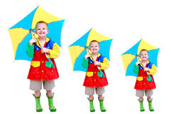 Coverage in case of a leak. Triple image of a little boy wearing a raincoat, rubber boots and holding a brightly colored umbrella provides triple coverage in Royalty Free Stock Images