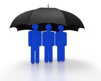 Coverage or protection as a concept. Small Group of persons under the coverage of an Umbrella Royalty Free Stock Photography
