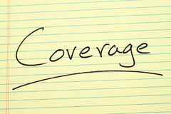 Coverage On A Yellow Legal Pad. The word `Coverage` underlined on a yellow legal pad Royalty Free Stock Photo