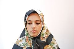 Covered. Muslim girl with calm look Royalty Free Stock Images