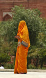 Covered. Lady totally wrapped in orange Royalty Free Stock Photo