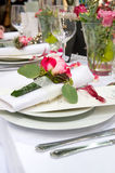 Covered banquet with red roses Stock Photo
