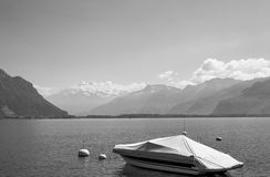 A covered boat on a lake. A black and white photo of a covered boat on a lake in Montreux, Switzerland Royalty Free Stock Image