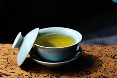 Covered bowl with tea Royalty Free Stock Photos