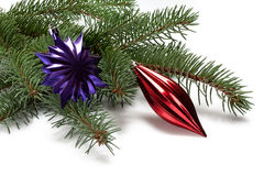 Covered with branch of a Christmas tree and purple snowflake Stock Photography