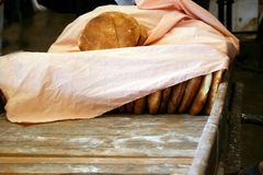 Covered bread on market stall Stock Images