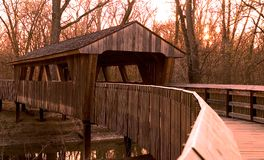 Covered Bridge. A covered bridge with a warm glow from sunset light stock photos
