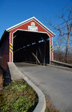 Covered Bridge. Red covered one-lane bridge Kissing bridge royalty free stock photo