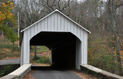 Covered Bridge. A wooden white covered bridge in autumn Stock Images