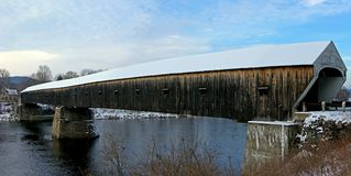 Covered Bridge. The Windsor-Cornish covered bridge, in winter, Cornish New Hampshire royalty free stock photo