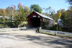 Covered Bridge in Autumn. This is a New England Covered bridge on a dirt road in the beginning of Autumn royalty free stock photography