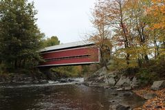 Covered Bridge. Balthazar Covered Bridge in Brigham over Yamaska River in Quebec Stock Photo